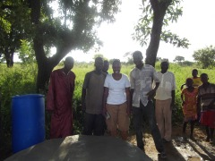 Tiffany and some men of Tijo snap a proud pic in front of thier finishedpolytank stand