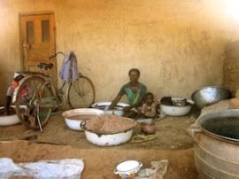 A woman making shea butter in Kpanayili