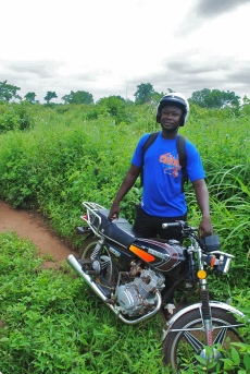Where would we be without our motos? CWS staffer TJ poses for a picture.