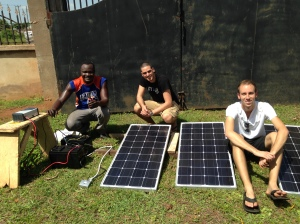 Shak, Mark, and Ben, checking out the fully-assembled Solar Panel system.