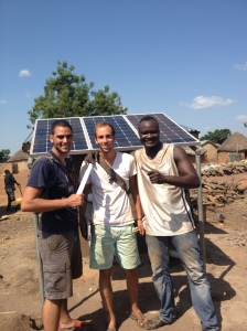 Mark, Ben, and Shak celebrating the completed solar panel installation.