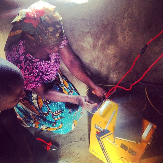 Salamatu hooking the Genset up to the solar panels