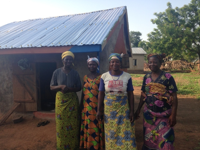 Saramatu, Damu, Lydia and Fuseina posing by the solar business after their first week of sales