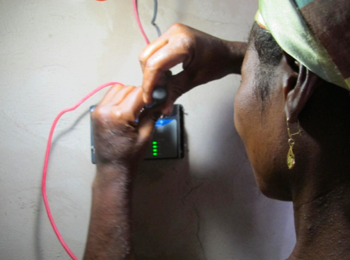 Sana learns to connect the solar panels wires to the microcontroller.